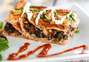 Black-Bean-Enchilladas-Topped-With-Cashew-Sour-Cream_LR-Watermark