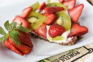 Slice of Raw Fruit Tart With Strawberries and Kiwi.