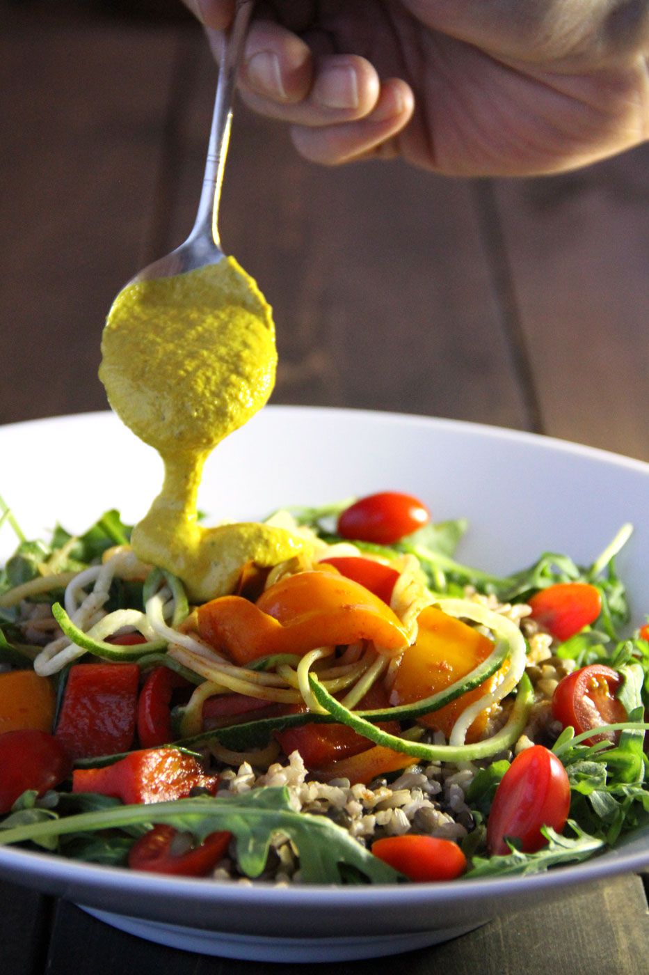 Spanish Style Nourish Bowl with An Amazing Vegan Cheese Sauce by active vegetarian portrait